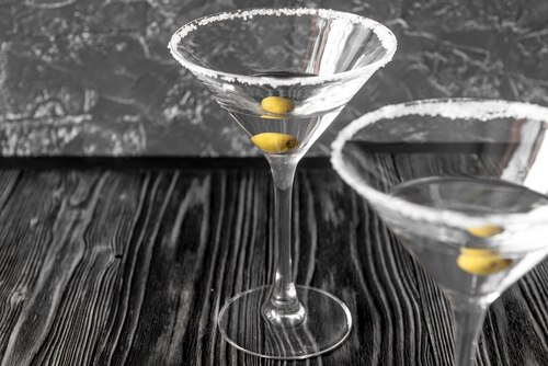 Two martini glasses with olives can be a lot of calories