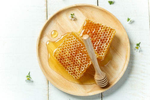A comb of honey on a plate