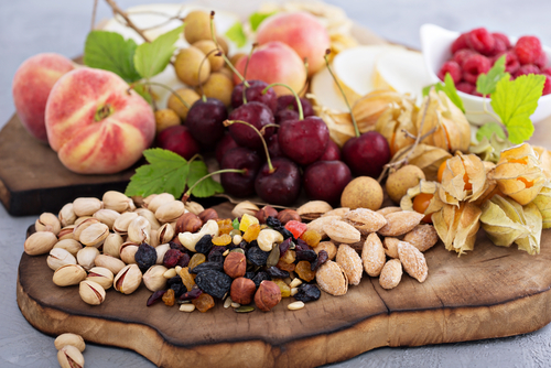 Snacks should consist of real, whole foods that balance your blood sugar and keep you satiated by providing enough protein and good fats
